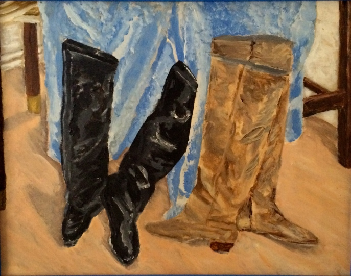 Two Pair of Boots Drying Against Blue Towel on Snowy Day