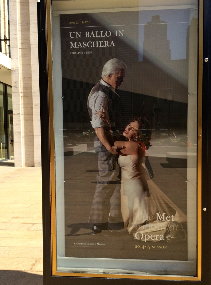 Ballo in Maschera (Verdi). That's Dimitri ______ threatening to kill his wife for a presumed adultery with the king and Sondra_______ (the blameless wife) pleading in her long slip for her life. If you try very hard, you can also see me reflected in the glass, trying to photograph them for you.